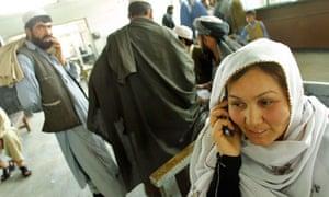 Afghan woman talks on mobile