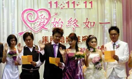 Newlywed couples during a mass wedding ceremony in Klang, Malaysia
