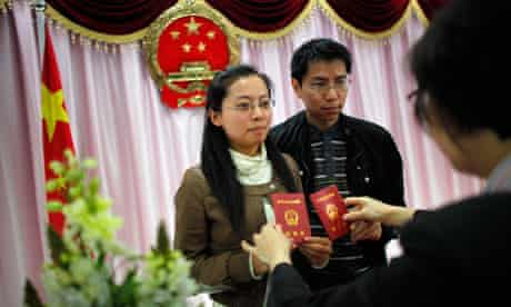 A couple hold their marriage certificates in Shanghai