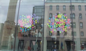 A view of Post-It notes stuck to a window from outside