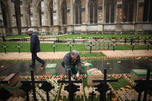 Armistice day: Bill Sellick plants remembrance crosses outside Westminster Abbey