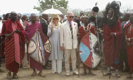 Prince Charles and the Duchess of Cornwall are given a traditional Maasi greeting in Tanzania