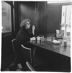 paris: Woman ar a counter smoking, N.Y.C by Diane Arbus