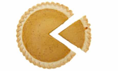 pumpkin pie with slice taken out
