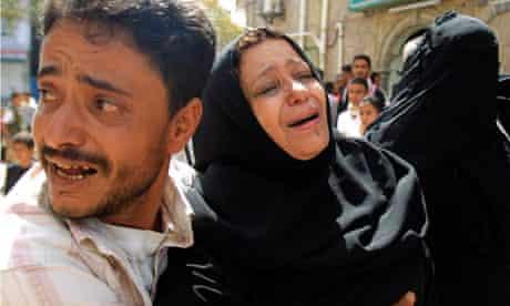 A woman mourns her son in Yemen city of Taiz