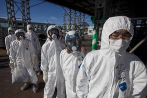 Inside Fukushima: Workers in protective suits