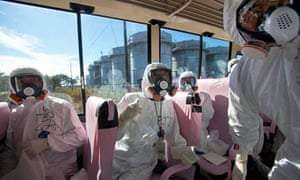 Officials from TEPCO and Japanese journalists at Fukushima