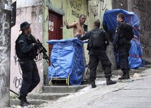 Rio raid: officers check a suspect