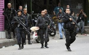 Rio raid: A policeman carries evidence