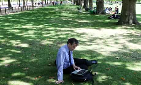 Man in London park with laptop