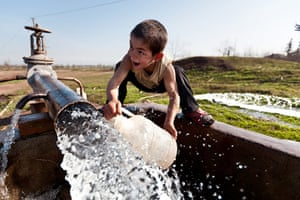 After the thaw: Azerbaijan: A young boy collects water in the Darğalar village of Barda