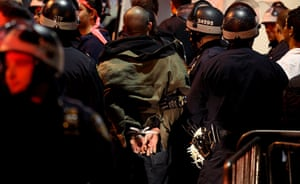 occupy wall street: a  protester is taken into custody by police