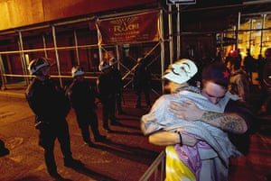 occupy wall street: Occupy Wall St activists console each other after being removed