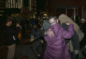 occupy wall street: Occupy Wall Street protestors embrace in New York