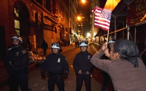 occupy wall street: A member of the Occupy Wall St movementwaves the stars and stripes