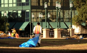 Occupy protest evictions: Oakland, US: A worker walks through Frank Ogawa Plaza