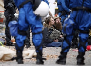 Occupy protest evictions: Zurich, Switzerland: Riot police surround protesters