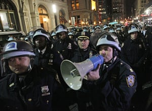 Occupy Wall St eviction: Police officers disperse protesters near the encampment