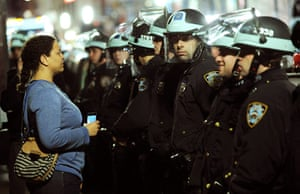 Occupy Wall St eviction: A woman looks at police in riot gear