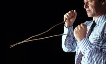 A man dowsing using a forked divining stick