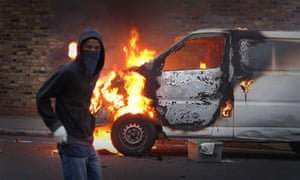 A rioter and a burning van