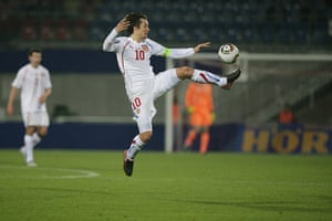 Euro 2012 qualifiers: Czech's captain Tomas Rosicky jumps for the ball