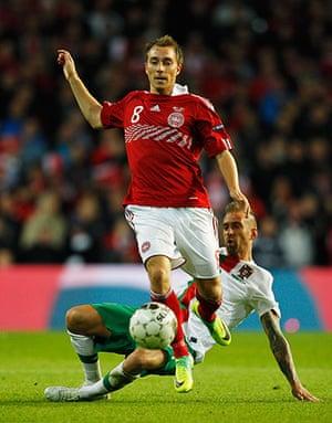 Euro 2012 qualifiers: Denmark's Christian Eriksen evades the challenge of Portugal's Meireles