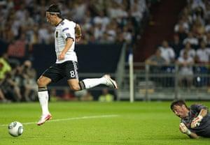 Euro 2012 qualifiers: Germany's Mesut Oezil scores past Austria's goalkeeper Christian Gratzei