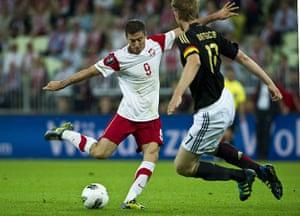 Euro 2012 qualifiers: Germany's Per Mertesacker blocks a shot by Poland's Robert Lewandowski