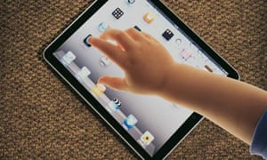 Techno-toddlers: child's arm and iPad