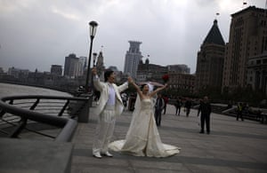 24 hours in pictures: A couple pose for wedding photos on the Bund