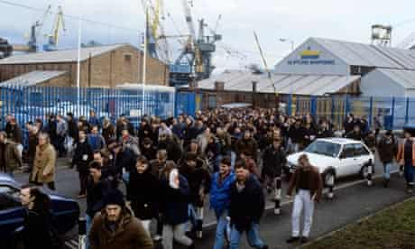 Workers head home after their shift at a Newcastle shipyard in the 80s.