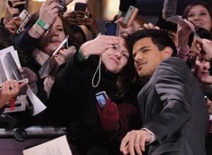 Twilight London premiere: Actors Lautner reacts as his photograph