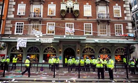 Riot police outside Fortnum & Mason in central London