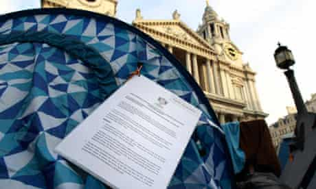 An eviction notice hangs on an Occupy tent outside St Paul's Cathedral