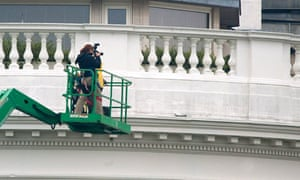 White House personnel inspect the south face of the building after the shooting