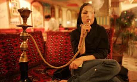 Iranian woman smoking water pipe