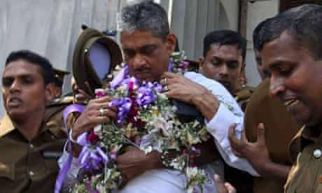 General Sarath Fonseka leaves a court in Colombo after being sentenced to three years in prison