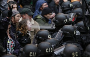 Occupy Day of Action: A police officer uses pepper spray on an Occupy Portland protester