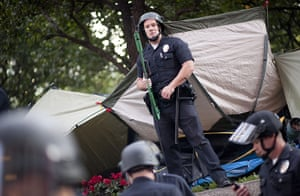 Occupy Day of Action: Los Angeles Police Department guards a pile of evicted Occupy LA tents