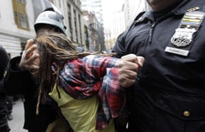 Occupy Day of Action: Police officers arrest a demonstrator with the Occupy Wall Street movement