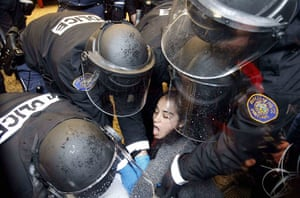 Occupy Day of Action: A Occupy Portland protester is arrested at Wells Fargo bank