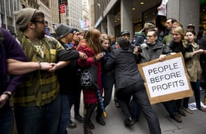 Occupy Day of Action: A businessman pushes a line of Occupy Wall Street protesters