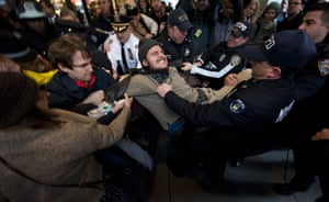 Occupy Day of Action: Occupy Wall Street protester is removed at New York Stock Exchange