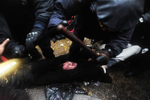 Occupy Day of Action: Police surround a protestor as they make numerous arrests in Zuccotti Park