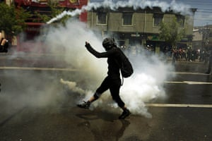 24 hours in pictures: Valparaiso, Chile: A masked protester