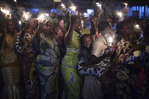 24 hours in pictures: Cotonou, Benin: Worshippers carry oil lanterns