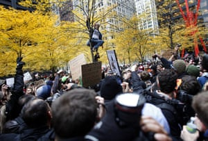 Occupy, Day of Action: An Occupy Wall Street protester climbs a tree in Zuccotti Park