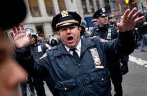 Occupy, Day of Action: A police officer demands protesters to move in the Financial District