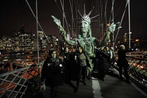 Occupy, Day of Action: Occupy Wall Street carry a puppet of the Statue of Liberty, Brooklyn Bridge